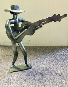 Metal sculpture by Lee Washington of a Guitar Player