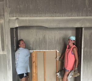 Lacy Hankins and Amanda Rutherford working on the new store
